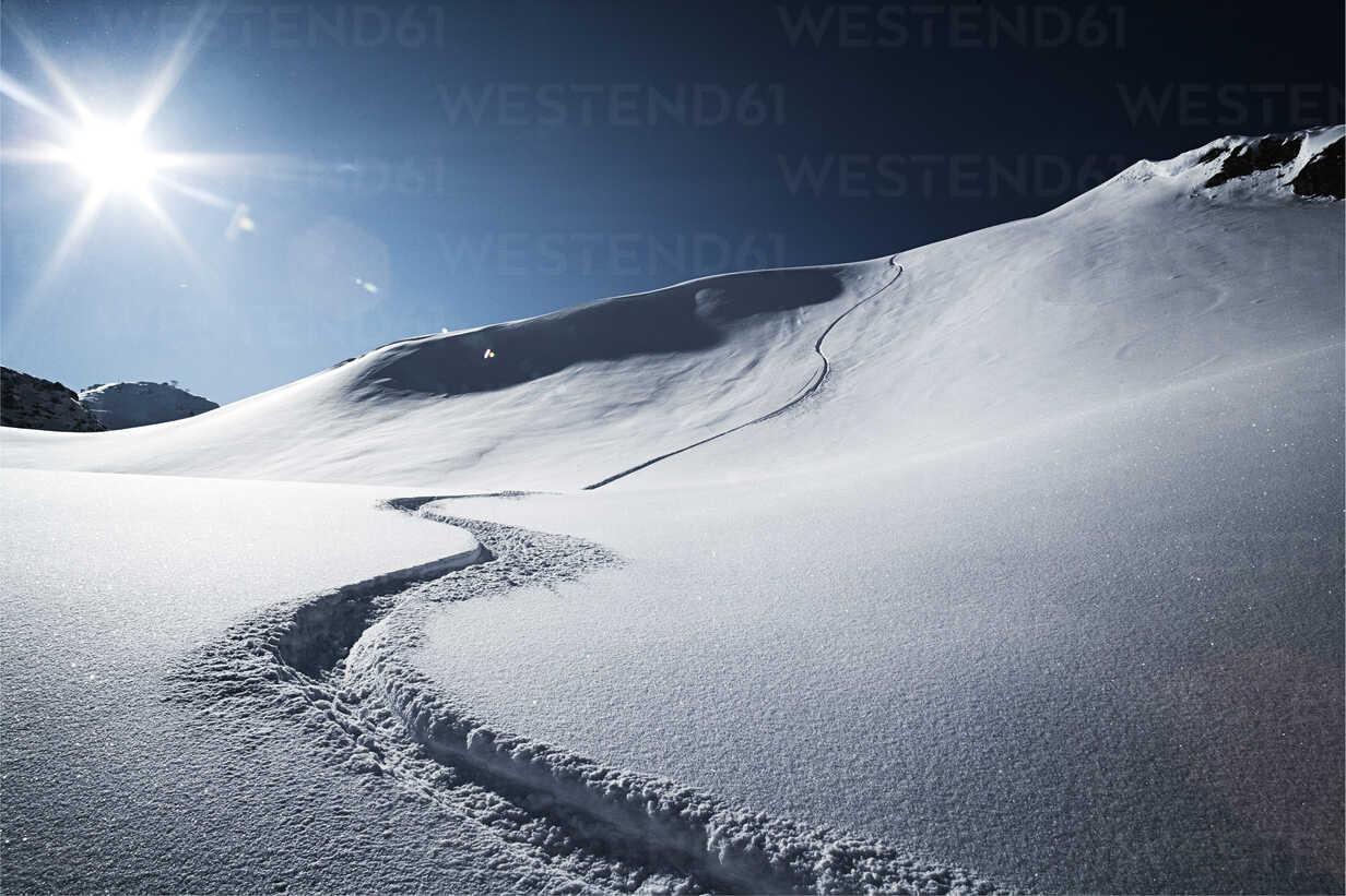 Austria, Tyrol, Ischgl, ski tracks in powder snow - ABF000640 - Bela Raba/Westend61