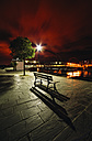Spain, Galicia, Naron, Promenade with a bench in the foreground at night - RAE000468