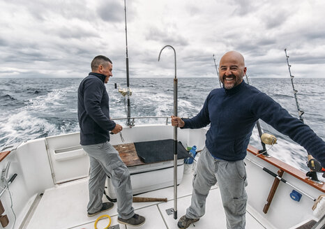 Spain, Asturias, Fishermen on fishing boat on Cantabrian Sea - MGOF000701