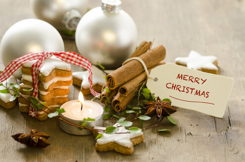 Christmas decoration, lighted tea light and stack of cinnamon stars - ODF001298