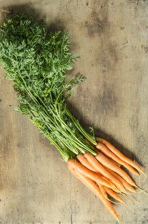 Bunch of carrots on wood - ODF001295