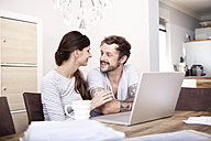 Happy couple together at home - MFRF000422