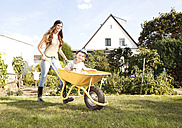 Woman with her little son sitting in a wheelbarrow - MFRF000436