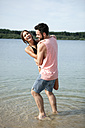 Germany, Haltern, young couple relaxing at Silbersee - GDF000870