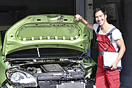 Car mechanic examining accident damaged car before repair - LYF000498