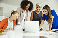 Smiling businesswomen having a meeting in conference room - MFF002170