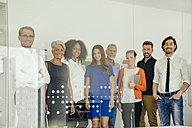 Portrait of smiling staff in office - MFF002178