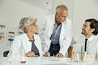 Three scientists talking in lab - MFF002182