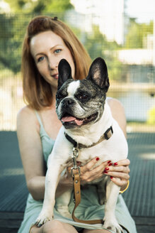 Portrait of dog with owner in the background - TAMF000300