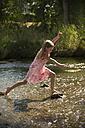 Girl walking through a brook - SARF002102