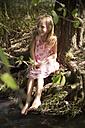 Happy girl sitting at a brook - SARF002103