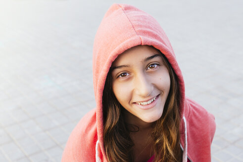 Portrait of smiling girl wearing red hooded jacket - GEMF000359
