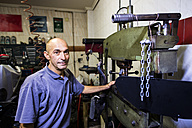 Portrait of mechanic in his workshop - JASF000104