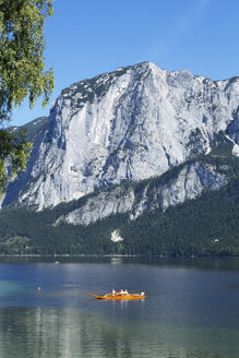 Austria, Styria, Altaussee, boat on lake with Trisselwand at Totes Gebirge - WWF003871
