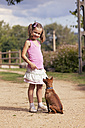 Portrait of smiling little girl with her dog - XCF000018