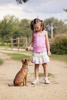 Little girl with her dog - XCF000020