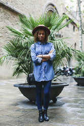 Spain, Barcelona, portrait of young woman wearing hat and denim shirt - EBSF000931