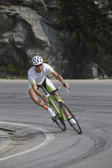 Switzerland, Engadin, cyclist on Bernina Pass - FF001461
