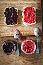 Homemade raspberry and blackberry jam with chia seeds, slices of bread - EVGF002435