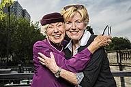 Germany, Berlin, portrait of two happy senior women head to head - TAM000316