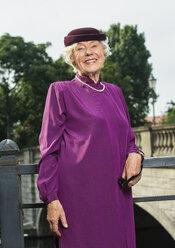 Germany, Berlin, portrait of fashionable senior woman - TAM000320