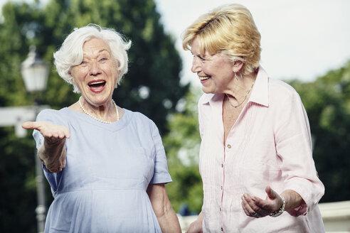 Germany, Berlin, portrait of two  senior women having fun - TAMF000338
