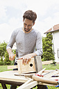 Man timbering a birdhouse - RBF003159