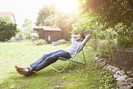 Man relaxing in garden chair - RBF003167