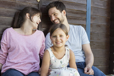 Happy family with daughter at garden shed - RBF003235