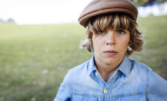Portrait of serious looking blond boy wearing cap - MGOF000764