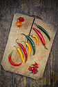 Different chili peppers on wood - LVF003887