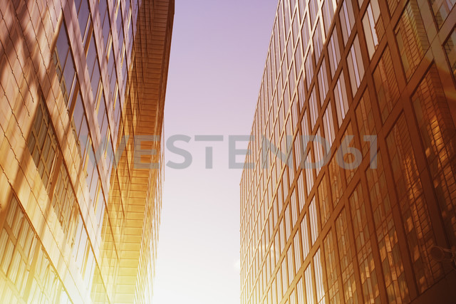 Sun shining between two modern office buildings - ZMF000431