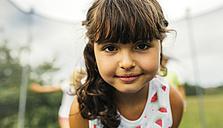 Portrait of brunette girl on trampoline - MGOF000797