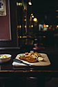 Wiener Schnitzel with French fries on restaurant table - AIF000090