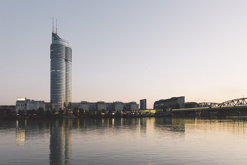 Austria, Vienna, Donau City, Danube River and Millenium Tower in the evening - AIF000099