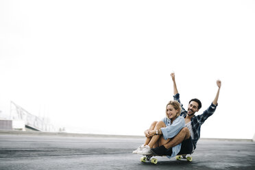 Young couple cruising on a longboard - JRFF000104