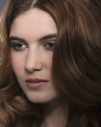 Portrait of rouged young woman with brown hair and brown eyes - NNF000231