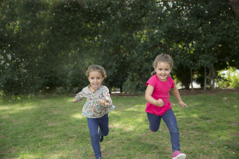 Two girls running in a park - ERLF000036