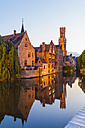 Belgium, Flanders, Bruges, Old town, Rozenhoedkaai, Canal and Belfry Tower in the evening - WDF003303