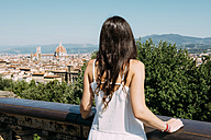 Italy, Florence, woman looking to the city from Piazzale Michelangelo viewpoint - GEMF000433