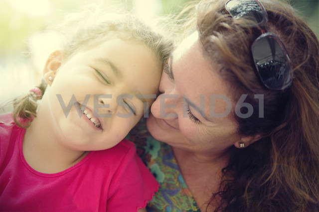 Woman cuddling with her little daughter - ERLF000044