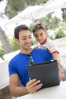 Portrait of father and son with digital tablet - ERLF000046