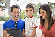 Parents and little son looking at digital tablet - ERLF000049
