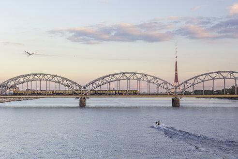 Latvia, Riga, railway bridge and TV Tower at the Daugava River in the evening - MELF000083