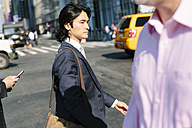 USA, New York City, businessman crossing the road in Manhattan - GIO000228