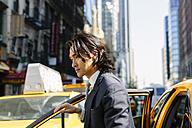 USA, New York City, businessman entering a taxi - GIOF000240