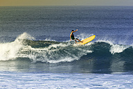 Indonesia, Bali, man surfing a wave - KNTF000102