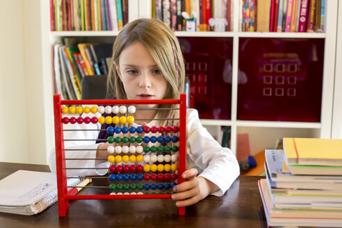 Girl using abacus at home - SARF002179