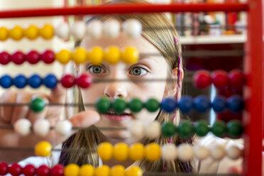 Girl using abacus - SARF002182