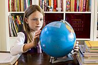 Girl looking at globe - SAR002188
